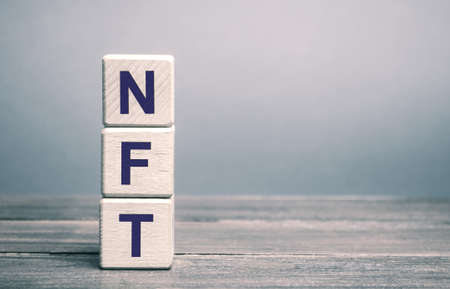 Wooden blocks NFT - non-fungible token. Digitally represented product or asset. Selling digital assets and art through auctions. Blockchain technology. Monetization, investment in cryptographic tokens Archivio Fotografico - 167121986
