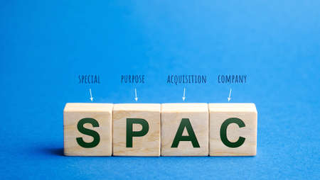 Wooden blocks with the word SPAC - Special purpose acquisition company. Simplified listing of company, merger bypassing stock exchange IPO. Assessment of benefits and risks of investments Archivio Fotografico - 167172829