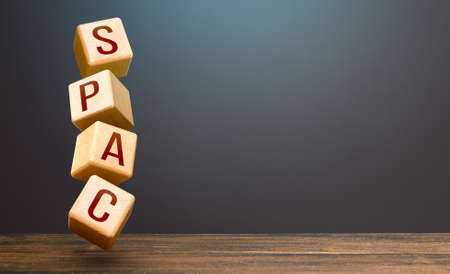Wooden blocks with word SPAC. Special-purpose acquisition company. A easy way stock exchange financial instrument for attracting investments. Development of new simplified procedures for investment