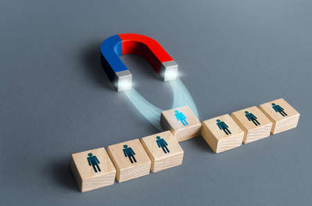 Magnet pulls a person out of row blocks. Choosing best candidate for hiring. Competition for a working high position of a manager. Poaching participants from other company team. Luring concept