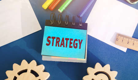 Notes with inscription Strategy. Actions designed to achieve the goals of the company. Achievement of goal. Plan, planning. Performance. Concept of business and finance