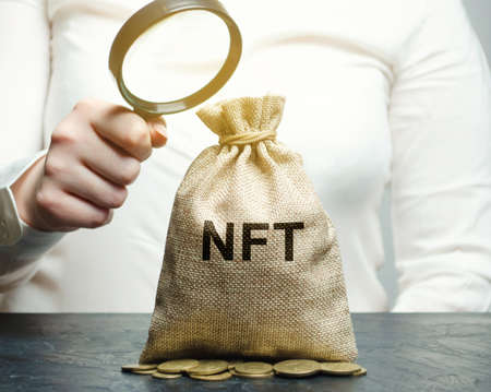 Money bag NFT is a non-fungible token. Digitally represented product or asset. Selling digital assets and art through auctions. Blockchain technology. Monetization, investment in cryptographic tokens