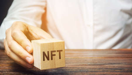 Wooden block NFT is a non-fungible token. Digitally represented product or asset. Selling digital assets and art through auctions. Blockchain technology. Monetization, investment in cryptographic tokens Archivio Fotografico