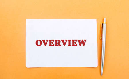 A note with the inscription Overview and a pen. Review, general idea. Business Plan Overview. Business concept. Presentation, report