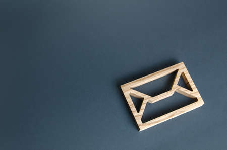 Wooden letter envelope. Contact concept. Postal correspondence. Mail notification. Communication internet technologies. Email. Business representations on the Internet and social media. Feedback