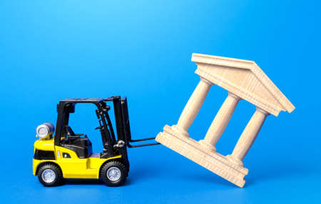 A forklift demolishes a bank building. Bankrupt bank liquidation procedure. Overthrow of government, dismantling of ruling elite. Financial system recovery. Elimination of the bureaucratized systems. Stock fotó