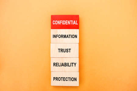 Wooden blocks with the words Confidential Information, trust, reliability, protection. Non-public oral or written business information. Undisclosed. Commercial secrets. Own. Property Stock fotó