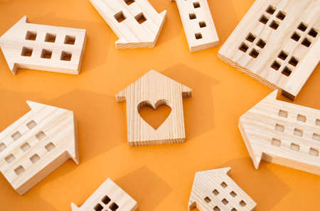 Many miniature wooden houses. Real estate concept. Choose affordable housing. Buying and selling housing. Market Analytics. Demand for housing. Rising and falling home prices. Population Stock fotó