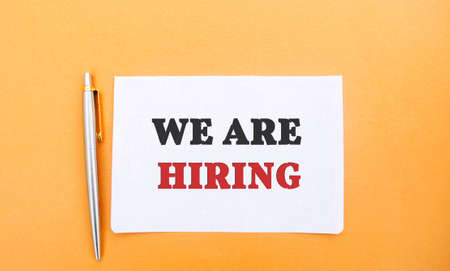 Notes with the inscription We are hiring and a pen. Employee Search. Attraction to work. Human Resource Management. Hire. Promotion. Working staff. Business concept Stock fotó
