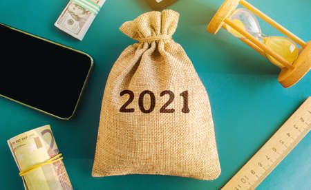 Money bag with the 2021. Budget planning for next year. Revenues expenses, investment and financing. Business plans and development prospects, trends. Income, GDP, analytics