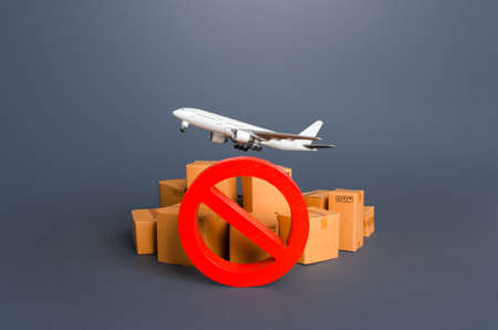 Cargo plane, boxes and red prohibition symbol NO. Embargo, a ban on commercial aircraft. Sanctions. Restrictions on export of strategically important goods and resources. Lack of transport capacity Stock fotó
