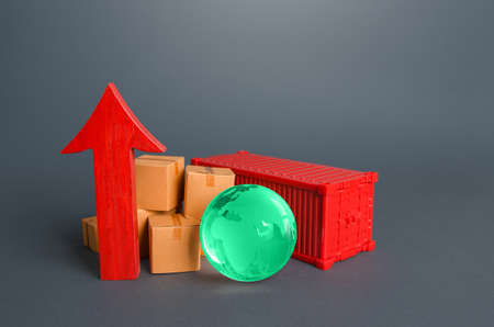 Shipping container and boxes near a red arrow up. Growth of goods transportation volume, world trade traffic recovery. Economic ties. Import and export. Fees and Tariffs, customs. Increase in sales. Stock fotó