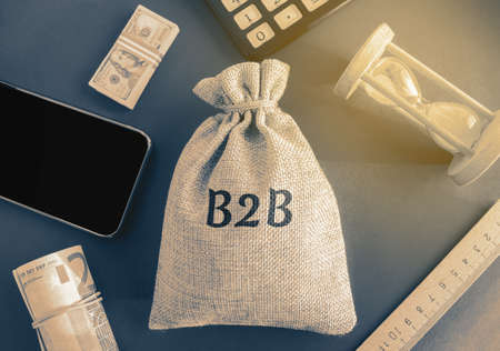 Money bag B2B (business-to-business). A business enters into a commercial transaction with another business. Commercial relationship, where another company or organization acts as a buyer.