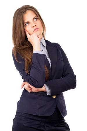 beautiful business girl thinks of work isolated on white background photo