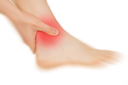 strength therapy: feet hurt, shown red, keep handed, isolated on white background Stock Photo