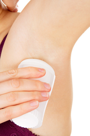 armpits: girl to smear armpits at the smell isolated on white background Stock Photo