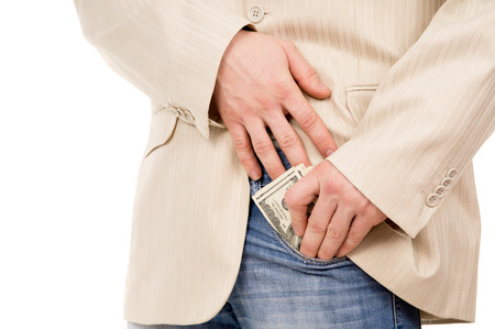 the man puts the money in his pants pocket isolated on white background