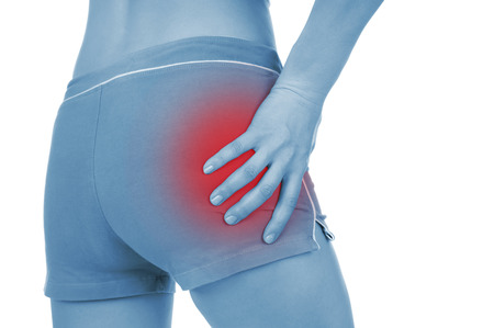 sore pelvis, shown red, keep handed, isolated on white background photo