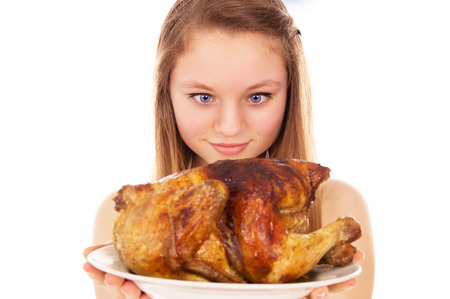 eagerly: Beautiful girl eagerly looking for fried chicken isolated on white background Stock Photo