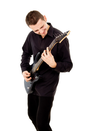a beautiful boy with electric guitar plays isolated on white background photo