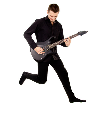 ��beautiful boy�: a beautiful boy with electric guitar, jumps isolated on white background Stock Photo
