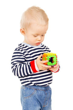 a little kid playing with a toy isolated on white background photo