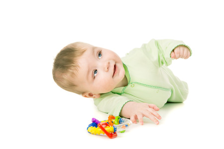 a small child is playing with toys isolated on white background Stok Fotoğraf