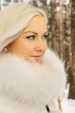 beautiful girl walks in the forest in winter