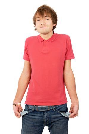 the handsome young man turned his pockets out and shows that he has nothing isolated on white background photo
