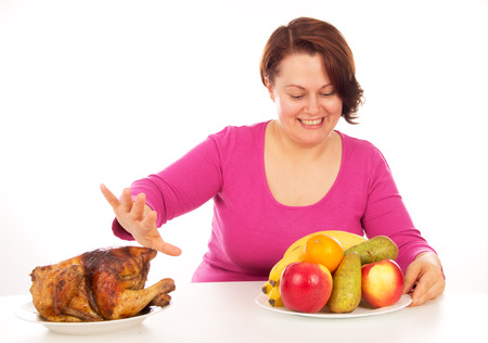 not full: Full woman does not want to eat chicken, isolated on white background
