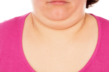 Full woman shows the second chin, isolated on white background