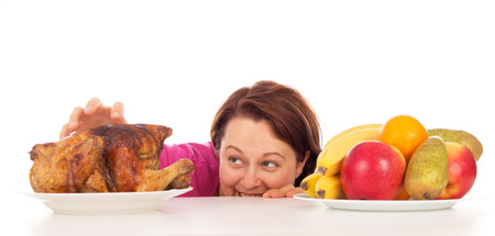 wants: Full woman wants to steal the chicken, isolated on white background Stock Photo