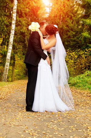 a young couple kissing on nature photo