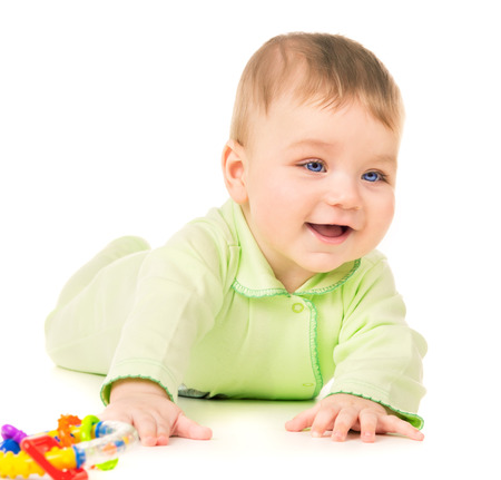 Beautiful baby crawling and playing with toys isolated on white background Stok Fotoğraf