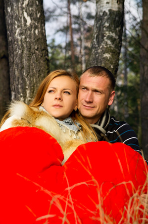 Married couple on nature in the woods photo