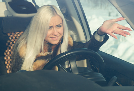 traffic jams: blonde in road angry, in the car Stock Photo
