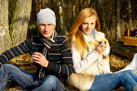 picnicking: Couple resting in nature in autumn