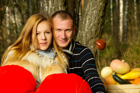 Beautiful young couple on nature in the woods photo