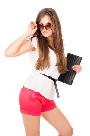 Glamor beautiful girl in sunglasses isolated on white background photo