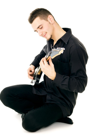 guy playing guitar: guy playing guitar isolated on white background Stock Photo