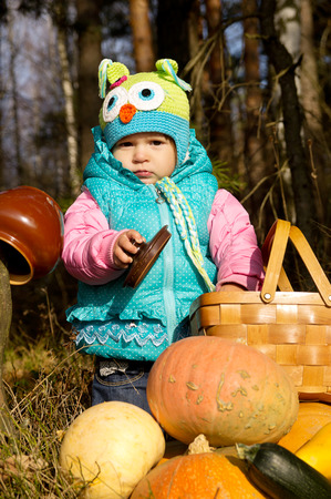 Little girl playing outdoors in autumn photo