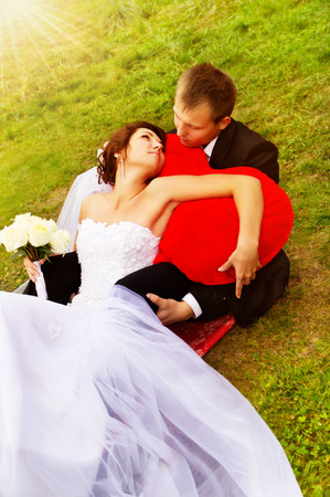 young couple lying on the grass on nature photo