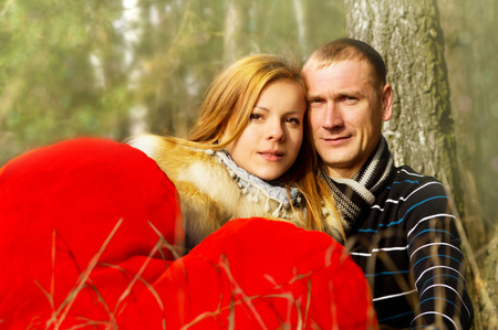 Young married couple on nature in the woods photo