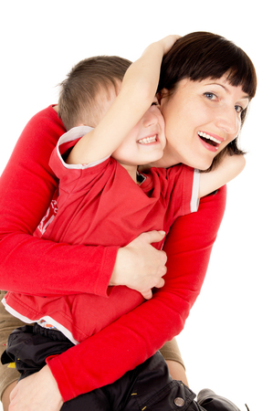 5 years old: mom hugging with a small child isolated on white background