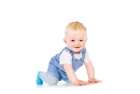 one year: the baby learns to crawl isolated on white background Stock Photo