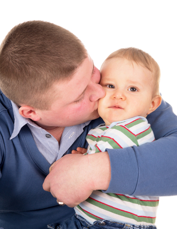lighthearted: the happy father kisses baby isolated on white background