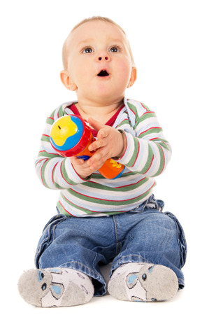 lighthearted: happy kid playing with toys isolated on white background