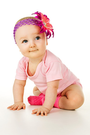baby isolated: beautiful little baby sitting isolated