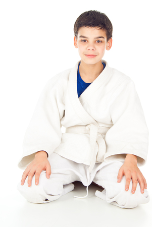receptions: boy sitting in the sports form of struggle Stock Photo