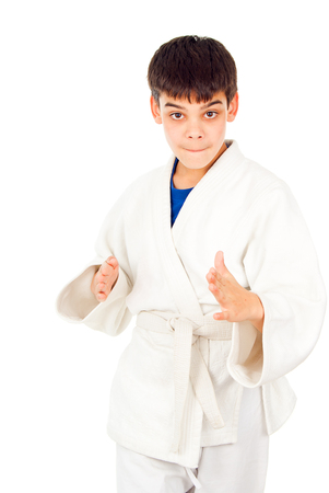 receptions: Taekwondo class boy isolated on a white background